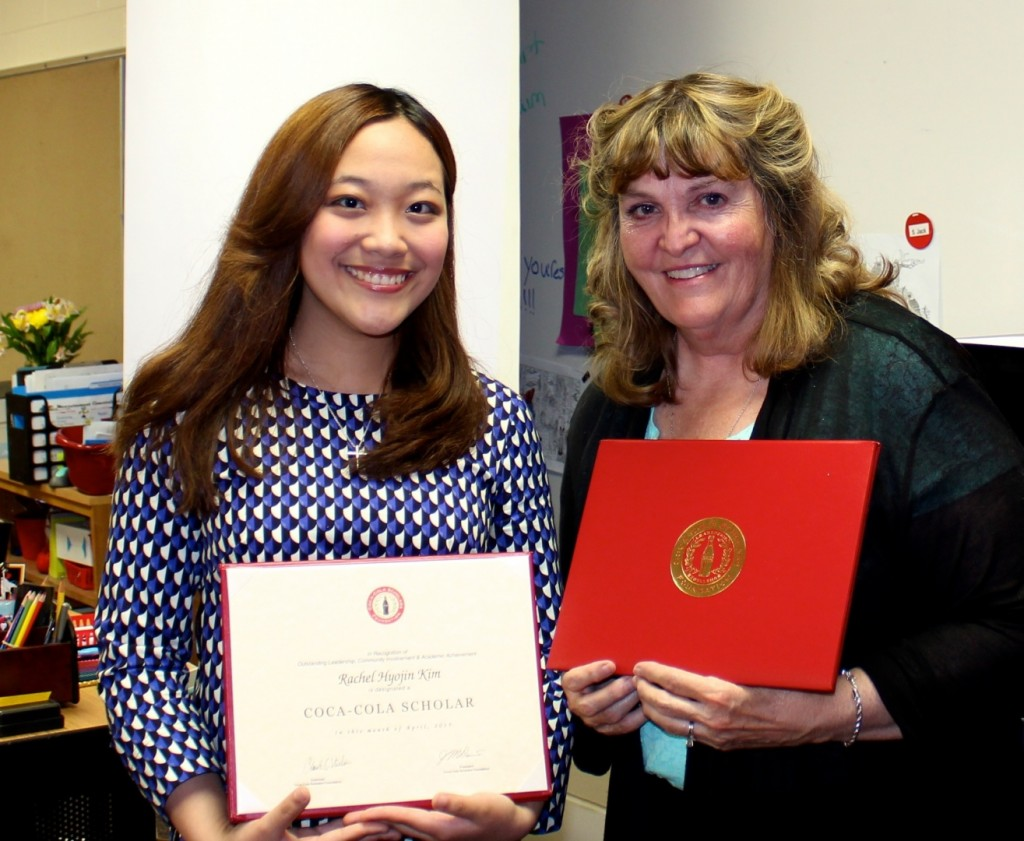 2015 Ames High School graduate Rachel Kim, (L) and Fellows fifth grade teacher Elise Wright display their Coca-Cola Scholars program awards. Kim is a national Coca-Cola Scholars winner who named Wright as a Distinguished Educator.