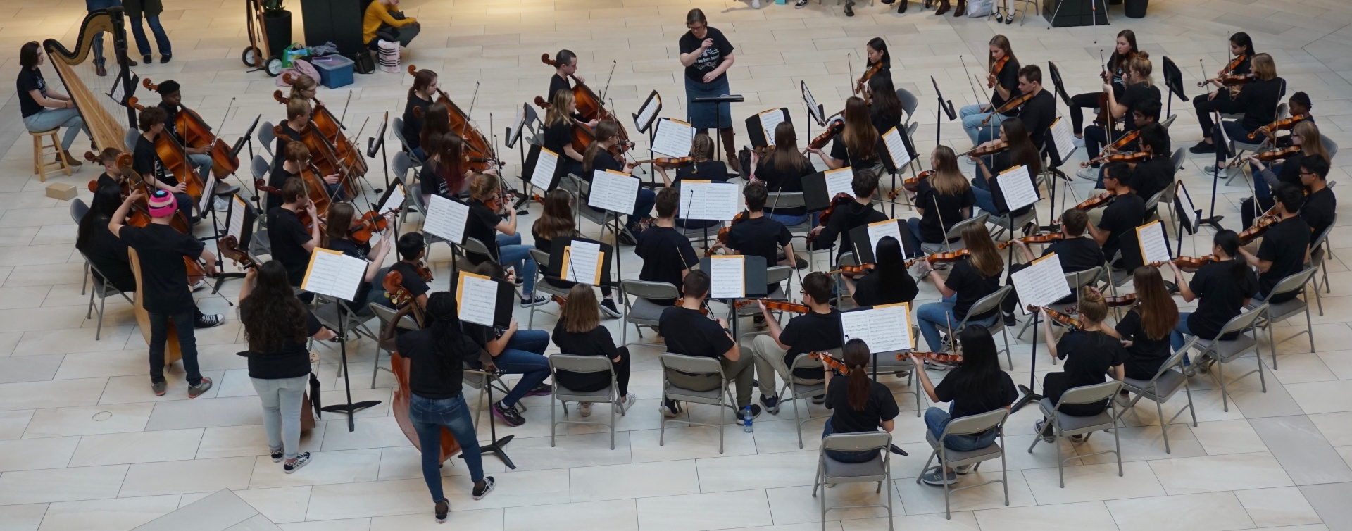 Orchestra students playing in mall
